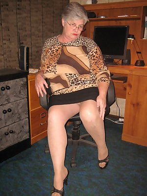 Leopard print sweater sexy bra and my black slip makes Girdlegoddess the perfect boss of the office.