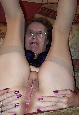 Busty mother with hairy pussy