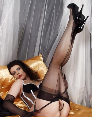 Elegant older lady relaxes in lingerie