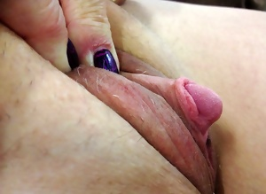 She loves to show her huge clit...