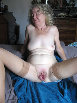 Granny plays with a vibrator