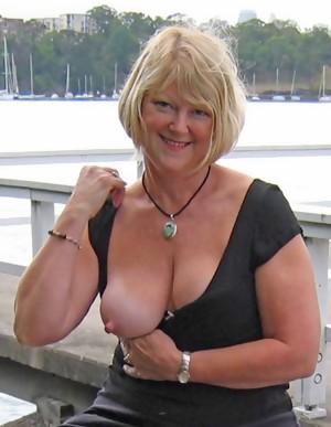 Naughty Granny slut getting herself horny
