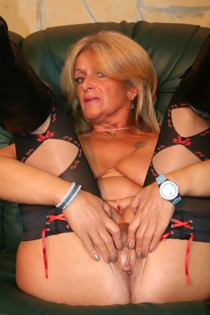 This big titted granny slut gets her holes filled