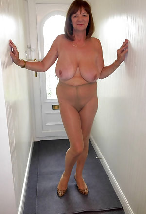 The nerdy granny in glasses and the suit is fucked at her work by eager guys