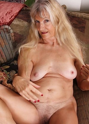 This hairy granny slut plays with a younger strapping man