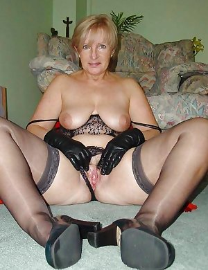 This horny blonde granny slut loves playing with herself