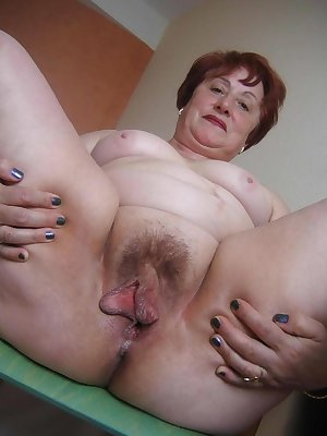 This horny granny slut loves to show us her hairy twat