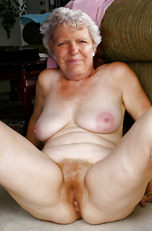 This horny blonde granny slut loves a cock coming through a hole
